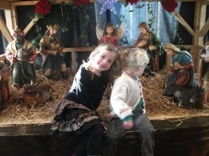 Lily and Jess admire the crib at the Carrickdale